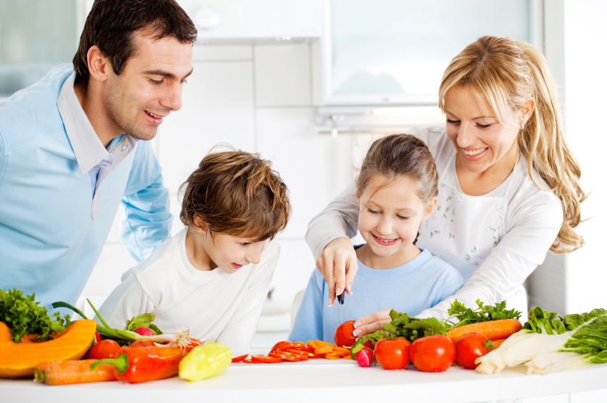 Portrait of a happy family preparing vegetables for meal together in the kitchen. [url=http://www.istockphoto.com/search/lightbox/9786778][img]http://dl.dropbox.com/u/40117171/family.jpg[/img][/url] [url=http://www.istockphoto.com/search/lightbox/9786682][img]http://dl.dropbox.com/u/40117171/children5.jpg[/img][/url]