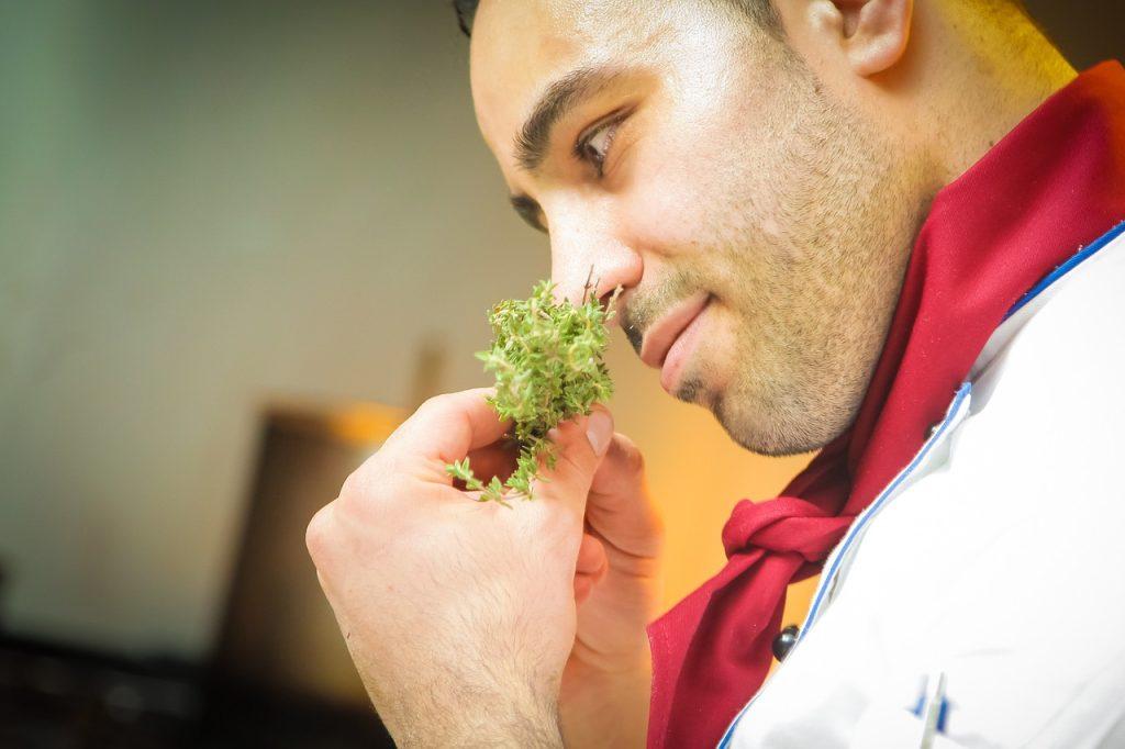 chef sniffs ingredients