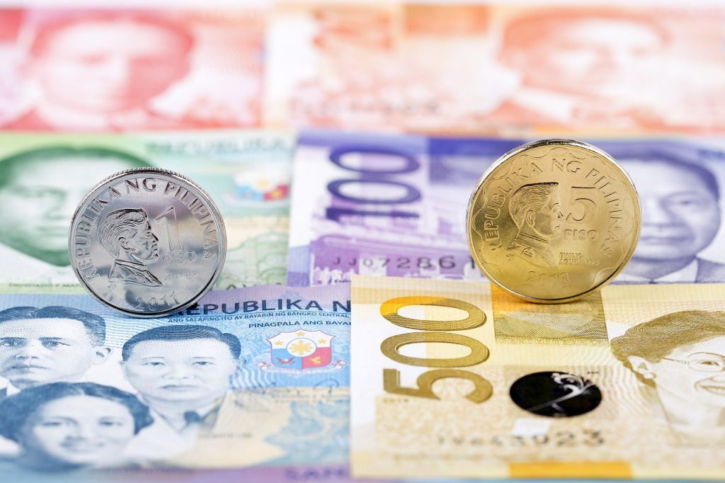 close-up of different philippine peso bills and coins