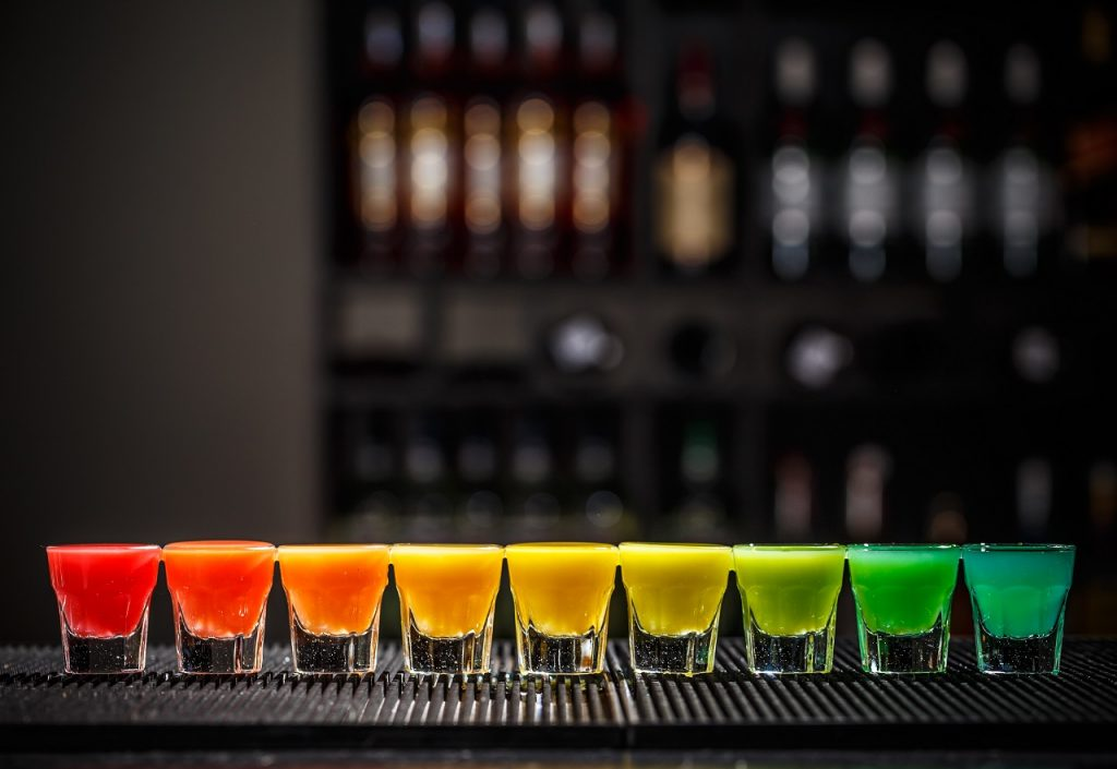shots with rainbow colors on a bar counter