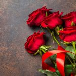 red roses on a dark stone table