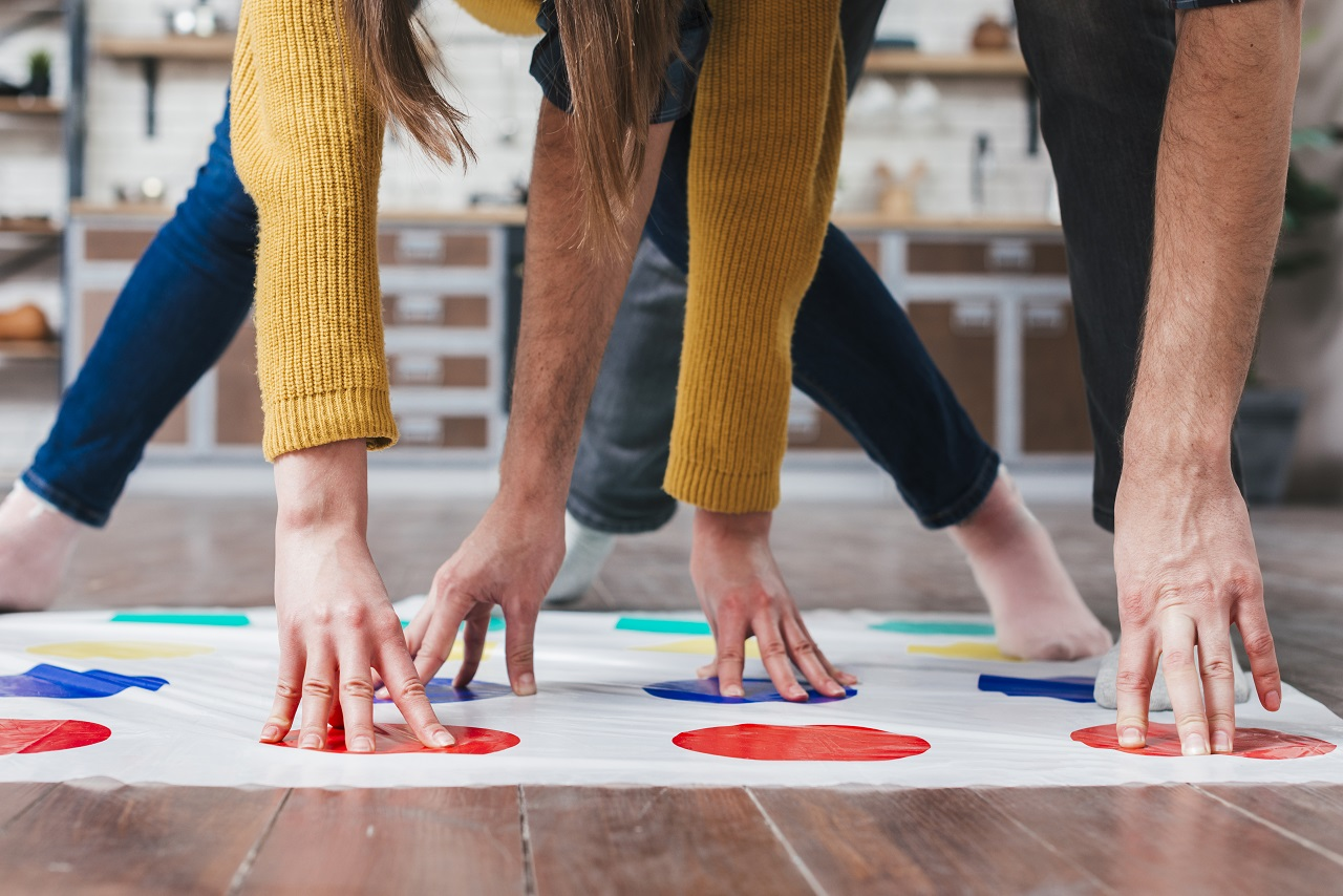 Close up of the arms and legs of people playing Twister