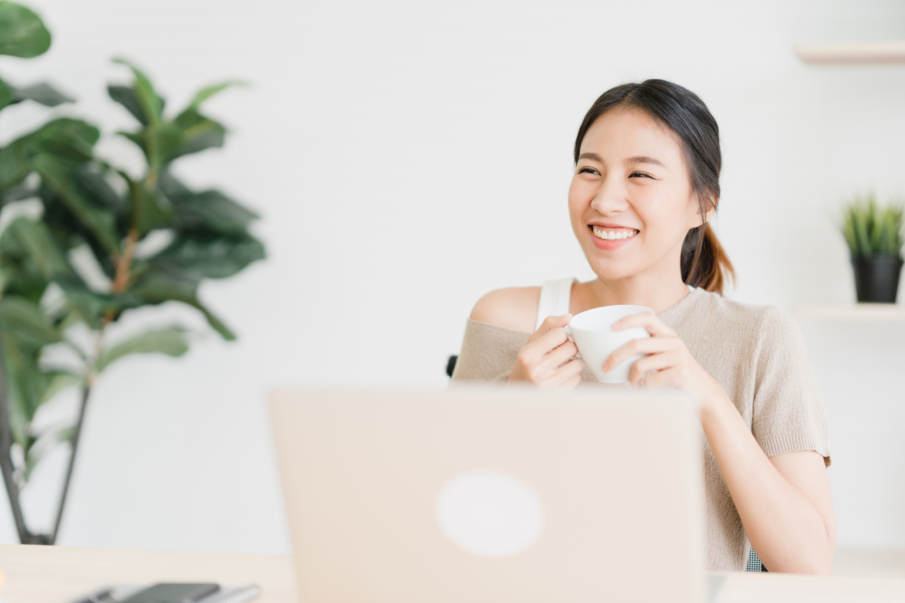 Girl smiling in front of her laptop