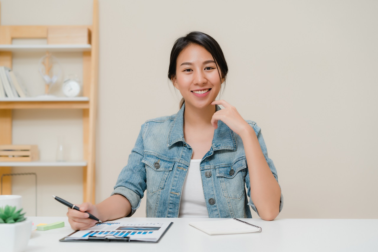 An asian girl smiling while planning a party