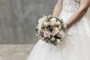 Close up of a bride holding a bouquet