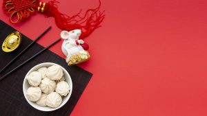 Chinese new year charms and a bowl of dumplings