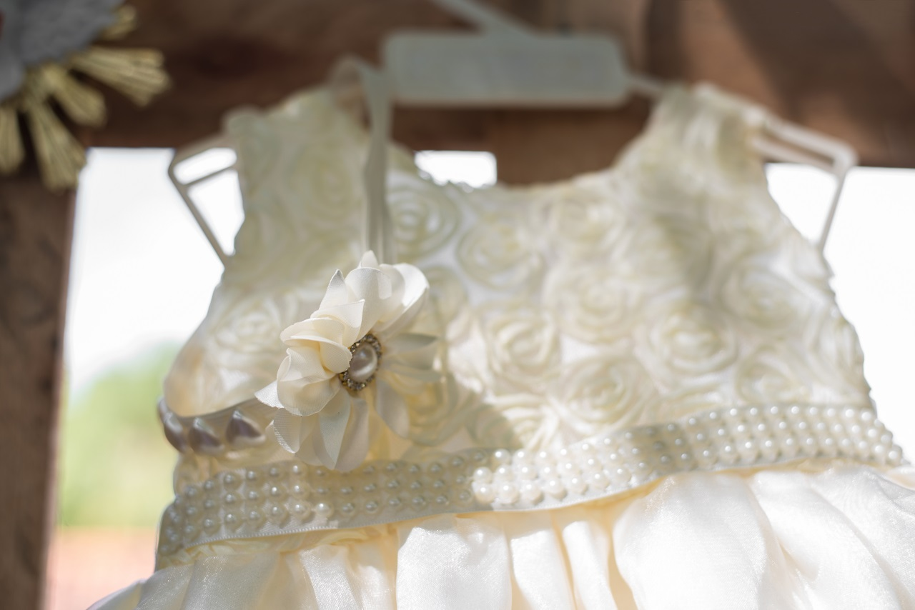 Close up of a baby's baptismal dress