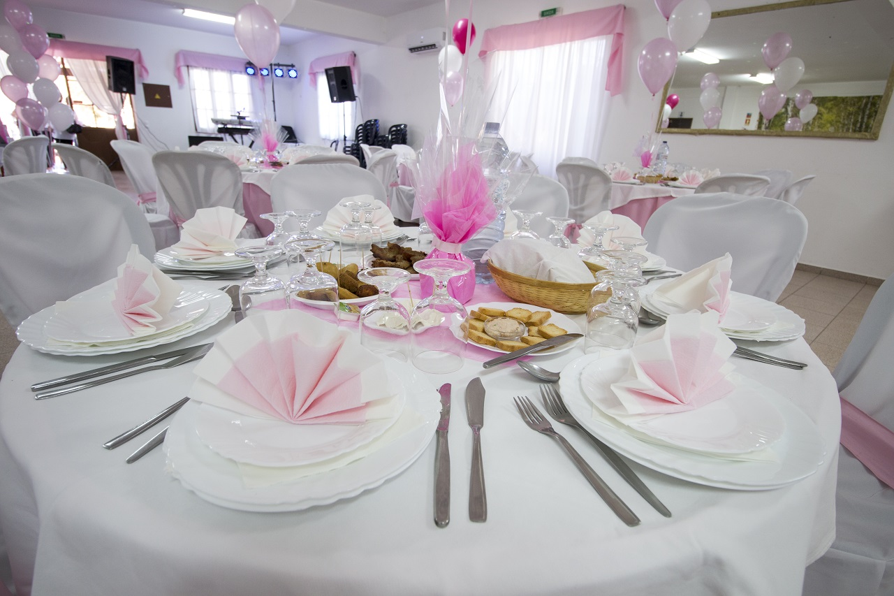 A table at a baby girl's baptismal party