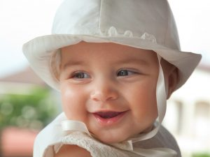 Close up of a baby girl in her baptismal attire