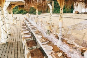 A long wedding table at the beach