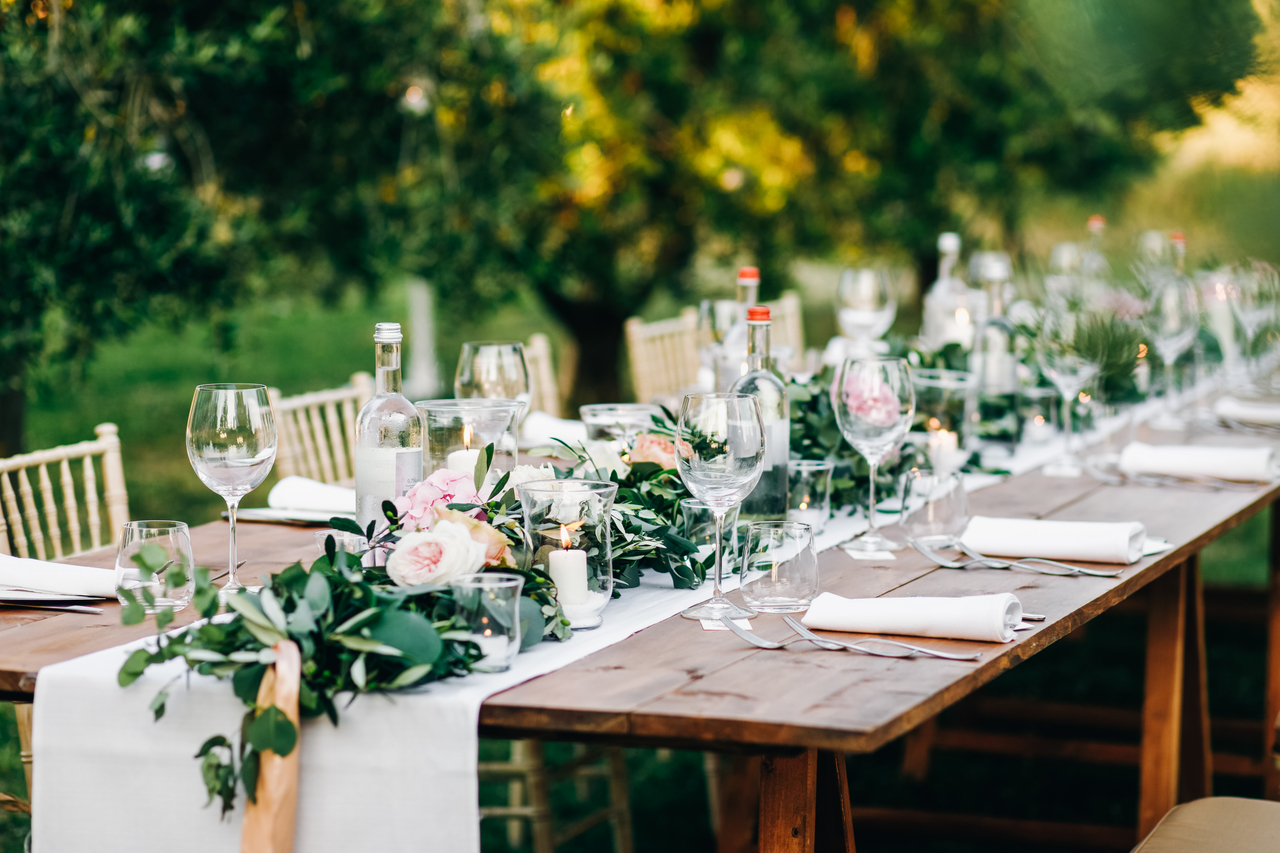 Wooden chairs and tables for an outdoor wedding reception