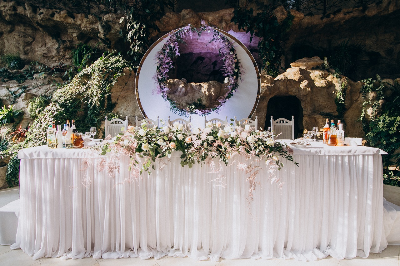 A bride and groom's table at a wedding reception