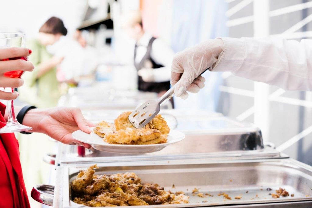 catering service serving food to wedding guests