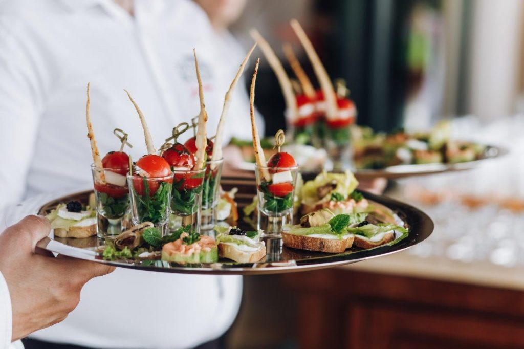 Catering service serving appetizers