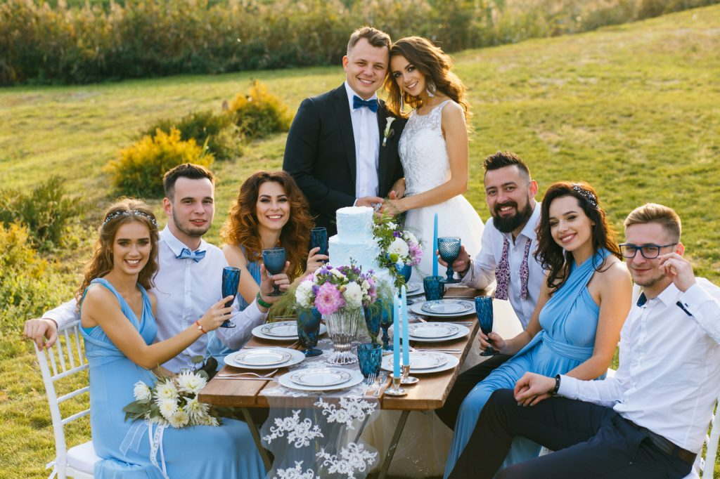 Newlyweds with their guests at an intimate wedding