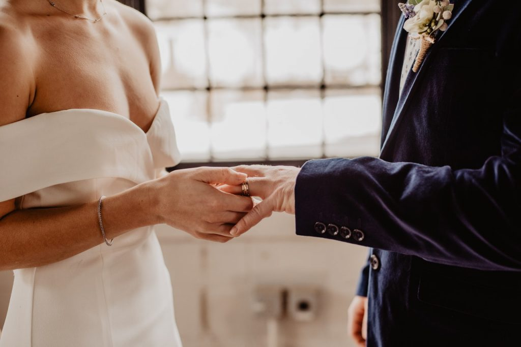A couple saying their vows in an intimate wedding venue