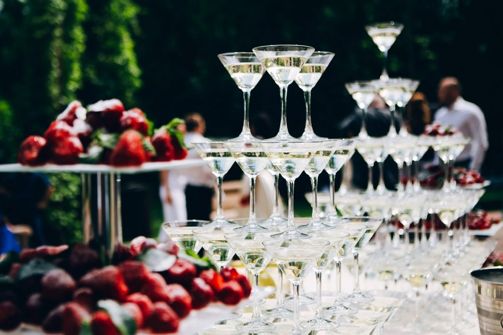martini glass pyramid. glasses for liquor on the table. buffet t