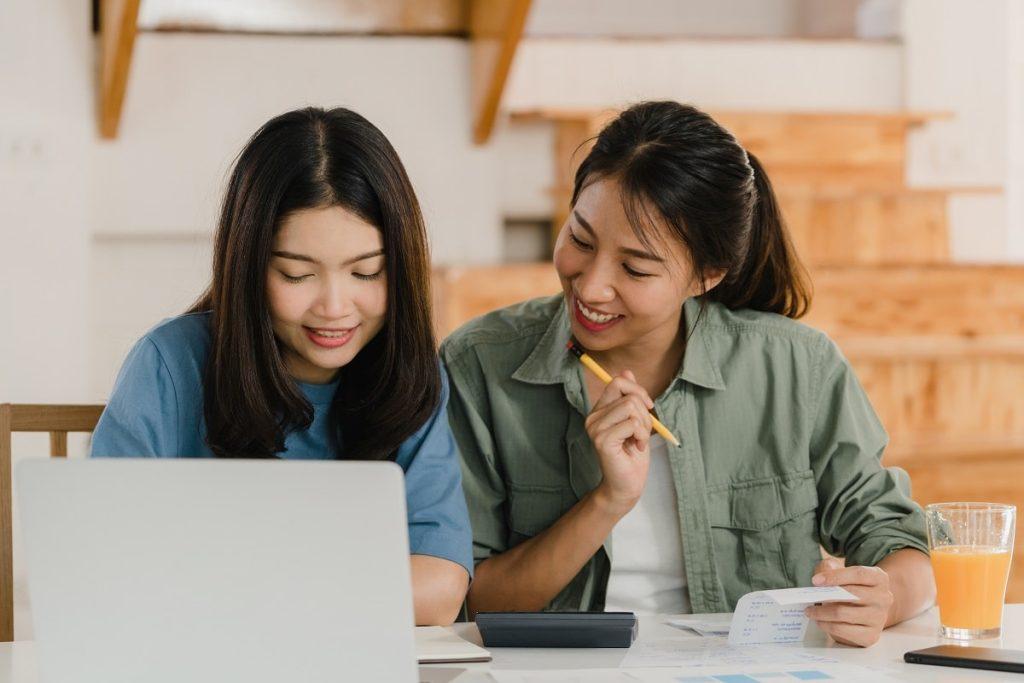 Business Asian women couple do account at home, Yo